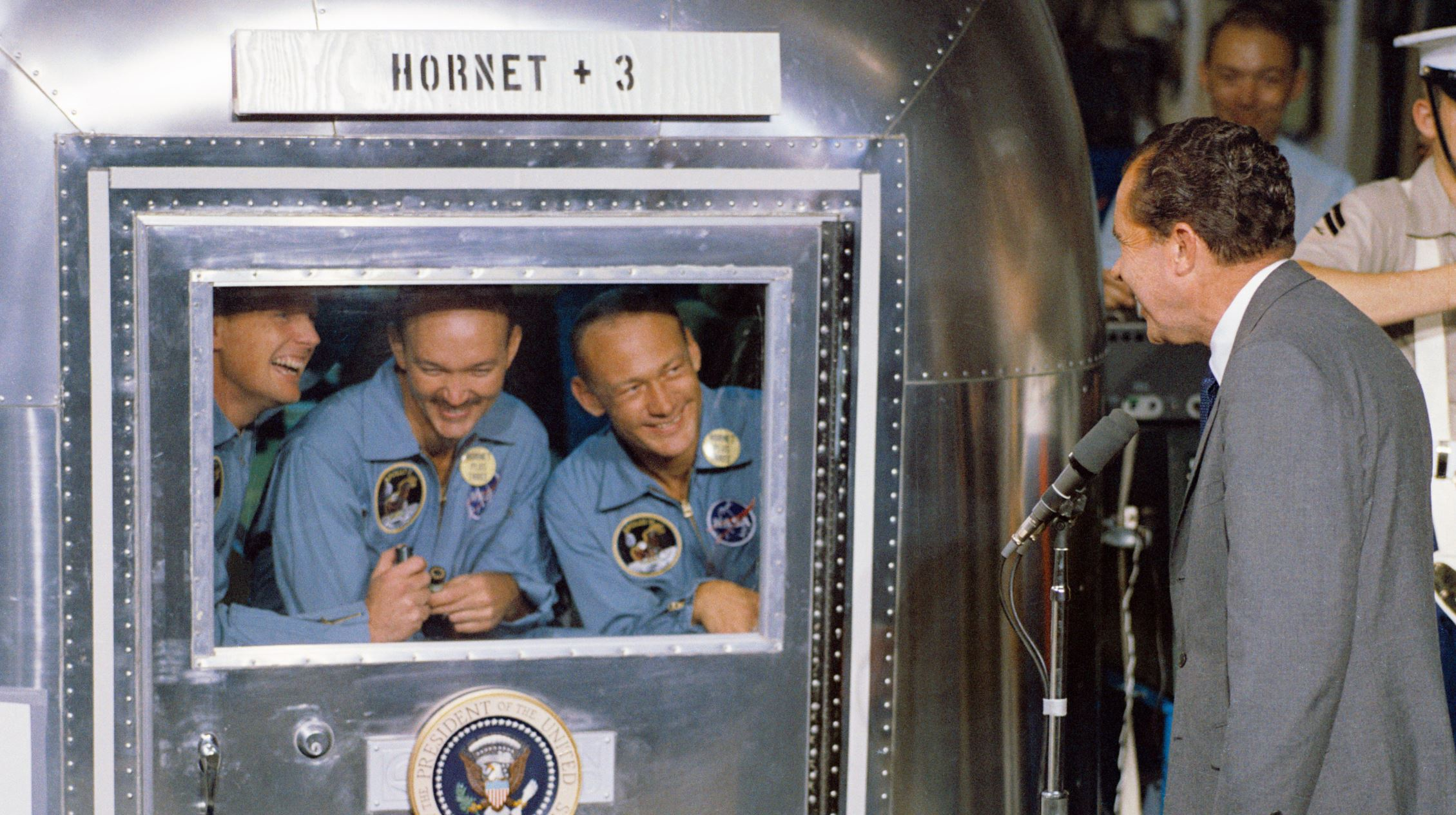 President Richard M. Nixon welcomes the Apollo 11 astronauts aboard the USS Hornet, the recovery ship for the mission, where they are quarantined. From left to right: Neil A. Armstrong, Michael Collins and Edwin E. Aldrin. - Image Credit:  NASA