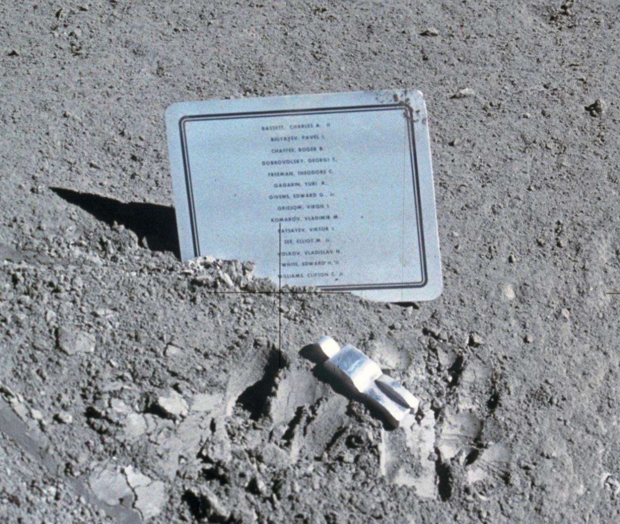 Apollo 15 astronauts David R. Scott and James B. Irwin left a commemorative plaque on the Moon in memory of 14 NASA astronauts and USSR cosmonauts. The tiny, man-like object represents the figure of a fallen astronaut/cosmonaut. - Image Credit:  NASA