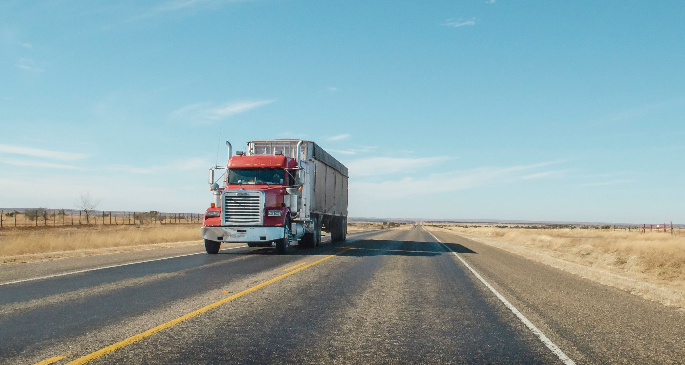 Heavy trucks such as this 18-wheeler contribute a significant fraction of the world's greenhouse gas emissions. MIT researchers say these emissions could be drastically reduced by using flex-fuel plug-in hybrid powertrains instead of diesel engines.  - Image Credit:  Matthew T Rader via Unsplash