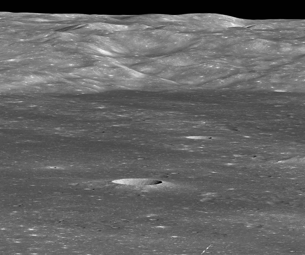 Arrows indicate position of Chang'e 4 lander on the floor of the Moon's Von Kármán crater. The sharp crater behind and to the left of the landing site is 12,800 feet across and 1,970 feet deep. - Image Credit:  NASA/GSFC/Arizona State University ,  CC BY