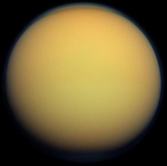This true-color image of Titan, taken by the Cassini spacecraft, shows the moon's thick, hazy atmosphere. - Image Credit: NASA