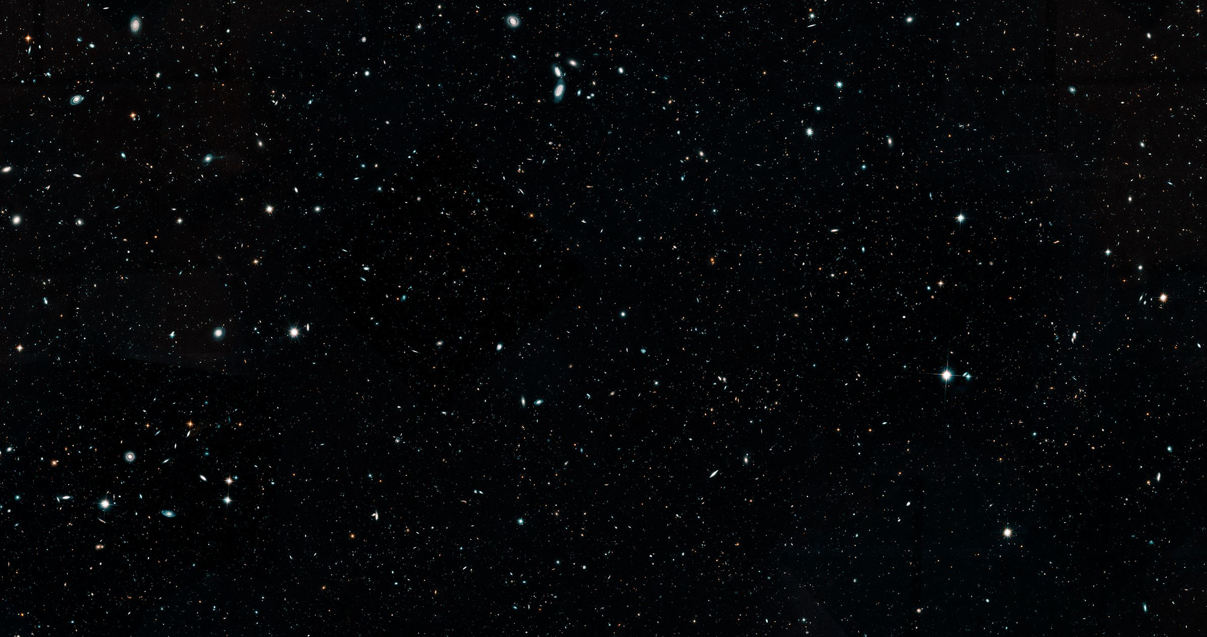 This Hubble Space Telescope image represents a portion of the Hubble Legacy Field, one of the widest views of the universe ever made. The image, a combination of thousands of snapshots, represents 16 years' worth of observations. The Hubble Legacy Field includes observations taken by several Hubble deep-field surveys, including the eXtreme Deep Field (XDF), the deepest view of the universe. The wavelength range stretches from ultraviolet to near-infrared light, capturing all the features of galaxy assembly over time. This cropped image mosaic presents a wide portrait of the distant universe and contains roughly 200,000 galaxies. They stretch back through 13.3 billion years of time to just 500 million years after the universe's birth in the big bang. - Image Credits: NASA, ESA, G. Illingworth and D. Magee (University of California, Santa Cruz), K. Whitaker (University of Connecticut), R. Bouwens (Leiden University), P. Oesch (University of Geneva) and the Hubble Legacy Field team
