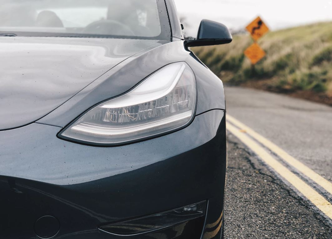 The Tesla Model 3, a critically acclaimed EV that has recently been released in Europe. - Image Credit:  Sung Wang via Unsplash