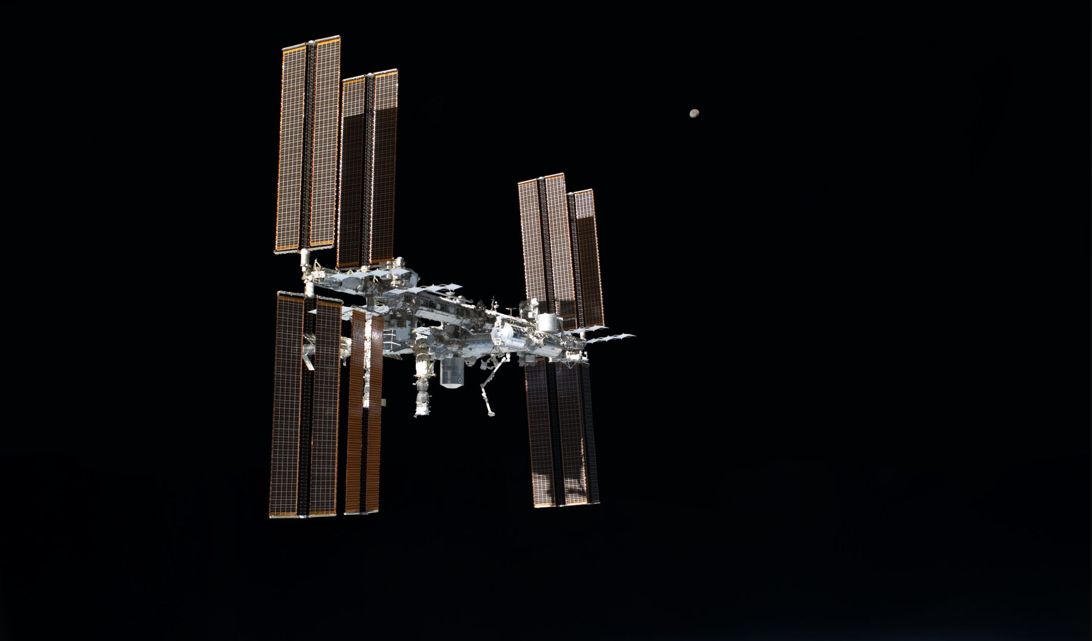The International Space Station with the moon in the background - Image Credit:  NASA via Wikimedia Commons
