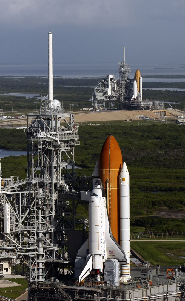 In the foreground, the space shuttle Atlantis stands ready for launch. A backup space shuttle (shown behind Atlantis) was also prepared for launch at NASA's Kennedy Space Center in Florida, in the event that the STS-125 crew experienced an emergency. - Image Credit: NASA