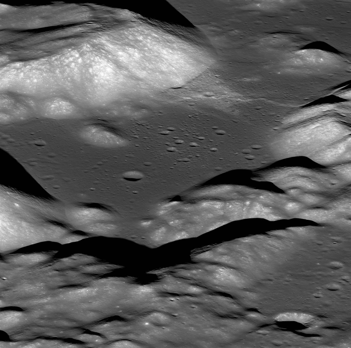 This is a view of the Taurus-Littrow valley taken by NASA's Lunar Reconnaissance Orbiter spacecraft. The valley was explored in 1972 by the Apollo 17 mission astronauts Eugene Cernan and Harrison Schmitt. They had to zig-zag their lunar rover up and over the cliff face of the Lee-Lincoln fault scarp that cuts across this valley. - Image Credits: [NASA/GSFC/Arizona State University - (click to enlarge)