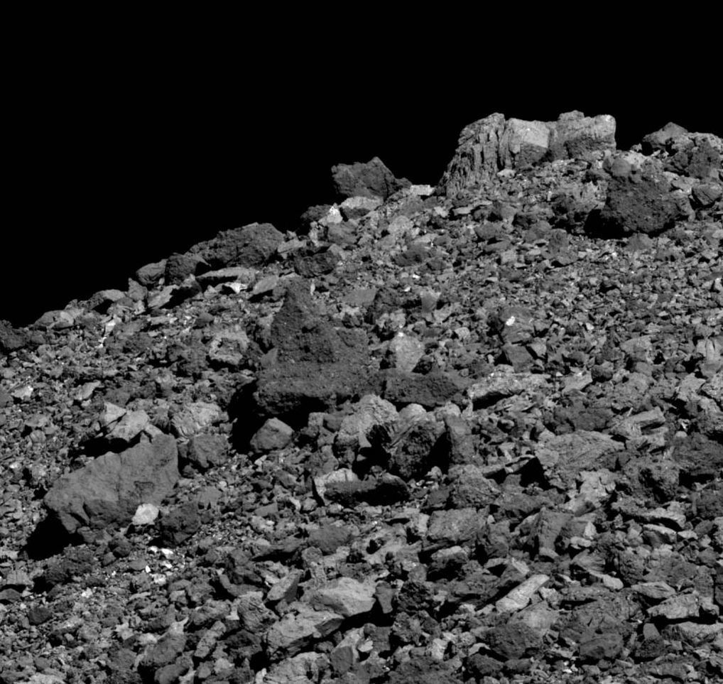 This image shows the wide variety of boulder shapes, sizes and compositions found on asteroid Bennu. It was taken by the PolyCam camera on NASA's OSIRIS-REx spacecraft on March 28 from a distance of 2.1 miles (3.4 km). The field of view is 162.7 ft (49.6 m). For scale, the large, light-colored boulder at the top of the image is 15.7 ft (4.8 m) tall. - Image Credits: NASA/Goddard/University of Arizona