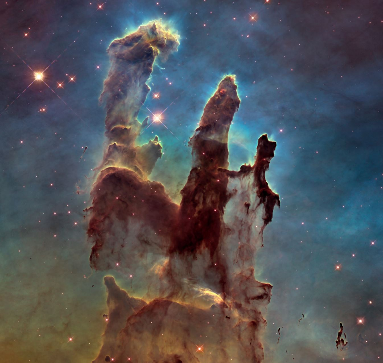 This image of the Pillars of Creation in the Eagle Nebula was captured by the newer WFC3. No staircase! It was taken as a tribute to the original Hubble WFPC2 image, but this one is much higher resolution thanks to the updated technology.- Image Credit:  NASA, ESA, and the Hubble Heritage Team (STScI/AURA) via Wikimedia Commons
