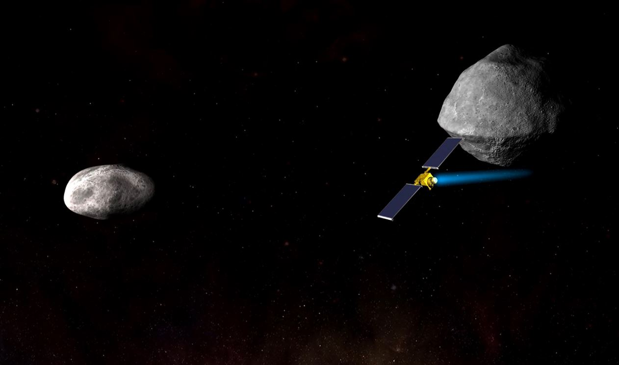 Artist's impression of NASA's Double Asteroid Redirection Test (DART) spacecraft speeding toward the smaller of the two bodies in the Didymos asteroid system. - Image Credits: NASA/Johns Hopkins University Applied Physics Laboratory