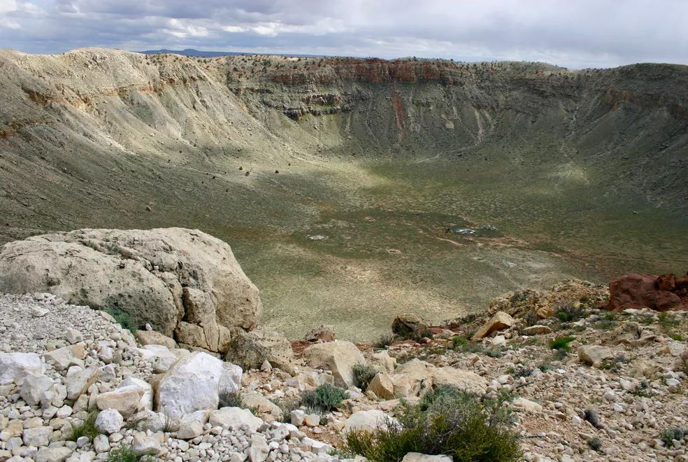 This meteor crater in Arizona was created 50,000 years ago when an iron meteorite struck the Earth. It is about one mile across. - Image Credits: W. Herbst,  CC BY-SA