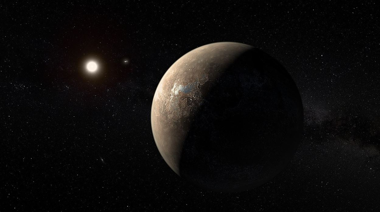 This artist's impression shows the planet Proxima b orbiting the red dwarf star Proxima Centauri, the closest star to our Solar System. The double star Alpha Centauri AB also appears in the image between the planet and Proxima itself. Proxima b is a little more massive than the Earth and orbits in the habitable zone around Proxima Centauri, where the temperature is suitable for liquid water to exist on its surface - Image Credit:  ESO/M. Kornmesser via Wikimedia Commons