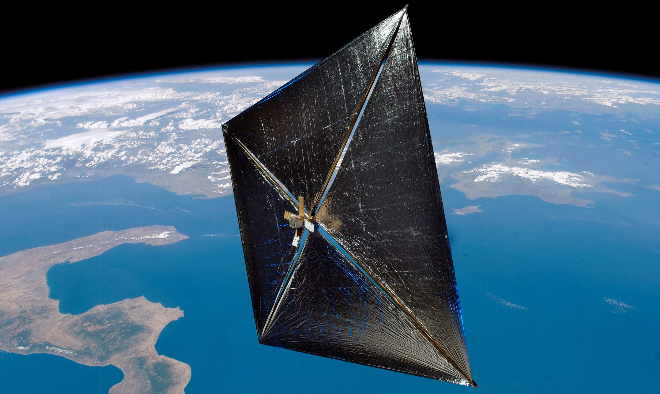 Artist's impression of the NanoSail D satellite in orbit with solar sail - Image Credit:  NASA via Wikimedia Commons