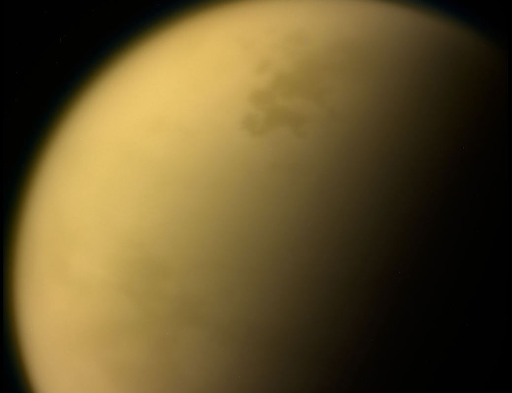 This view of Saturn's largest moon, Titan, is among the last images the Cassini spacecraft sent to Earth before it plunged into the giant planet's atmosphere. The thick, hazy atmosphere makes studying the moon extremely difficult. - Image Credit: NASA/JPL-Caltech/Space Science Institute