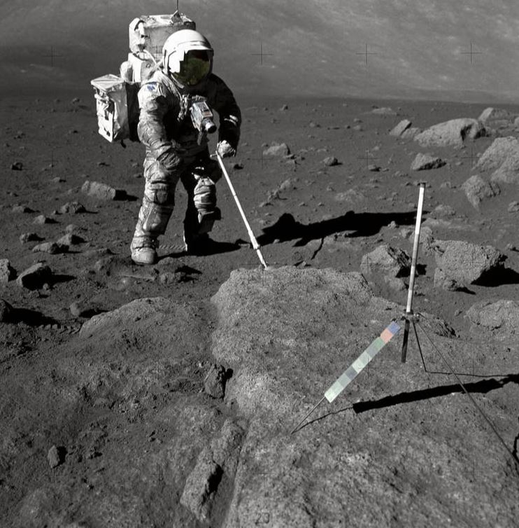 Harrison Schmitt trying to collect moon rock. - Image Credit: NASA