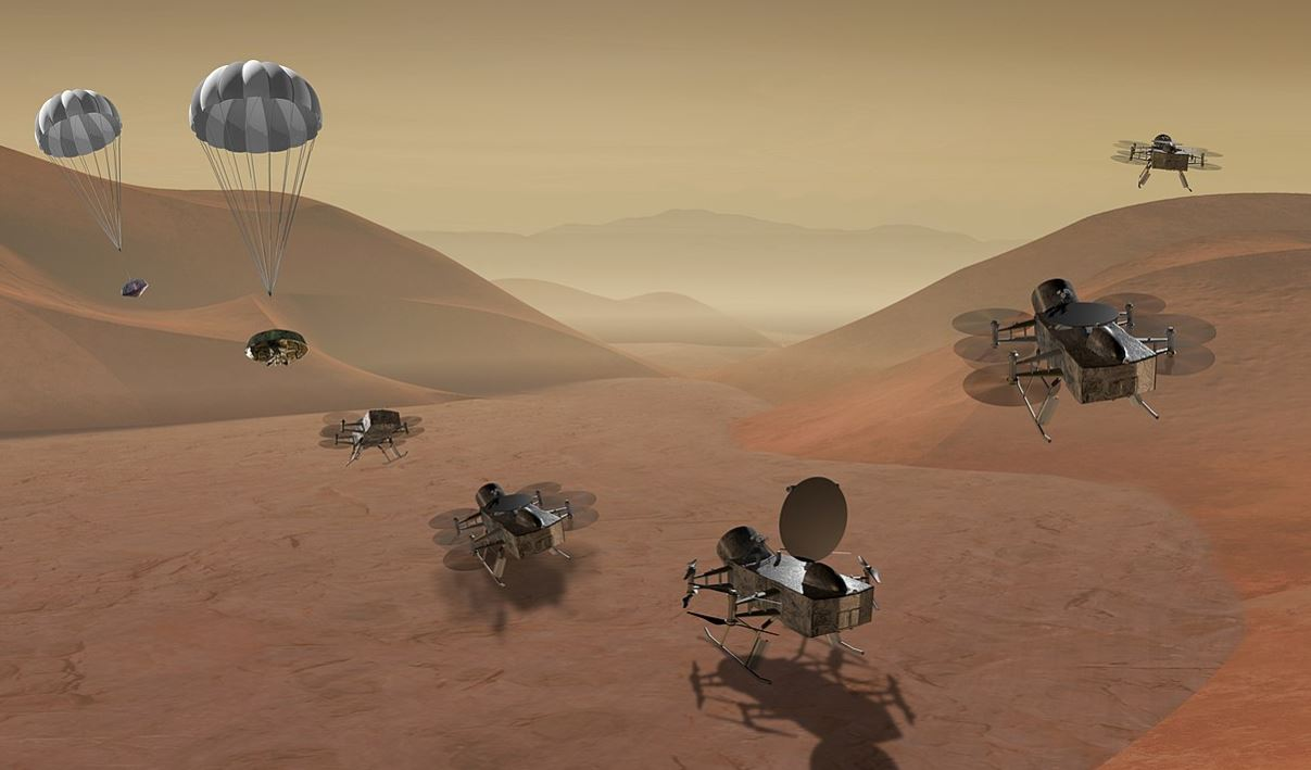 NASA graphic showing Dragonfly mission arriving on Saturn's moon Titan, and flying in its atmosphere.- Image Credit:  NASA via Wikimedia Commons