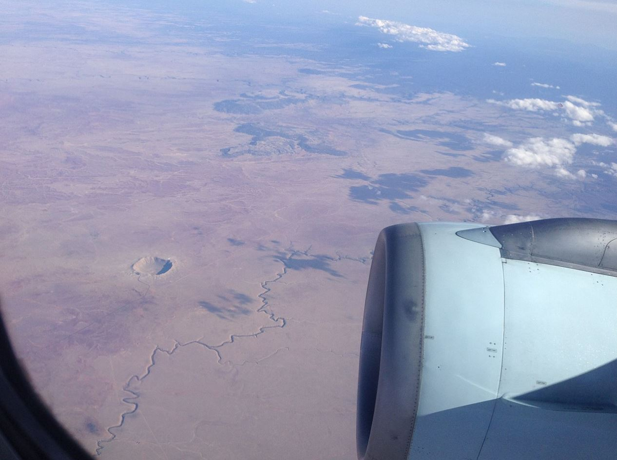 The Barringer Meteor Crater from 36,000 ft (11,000 m) in Arizona, USA.- Image Credits:  Devezolis via Wikimedia Commons