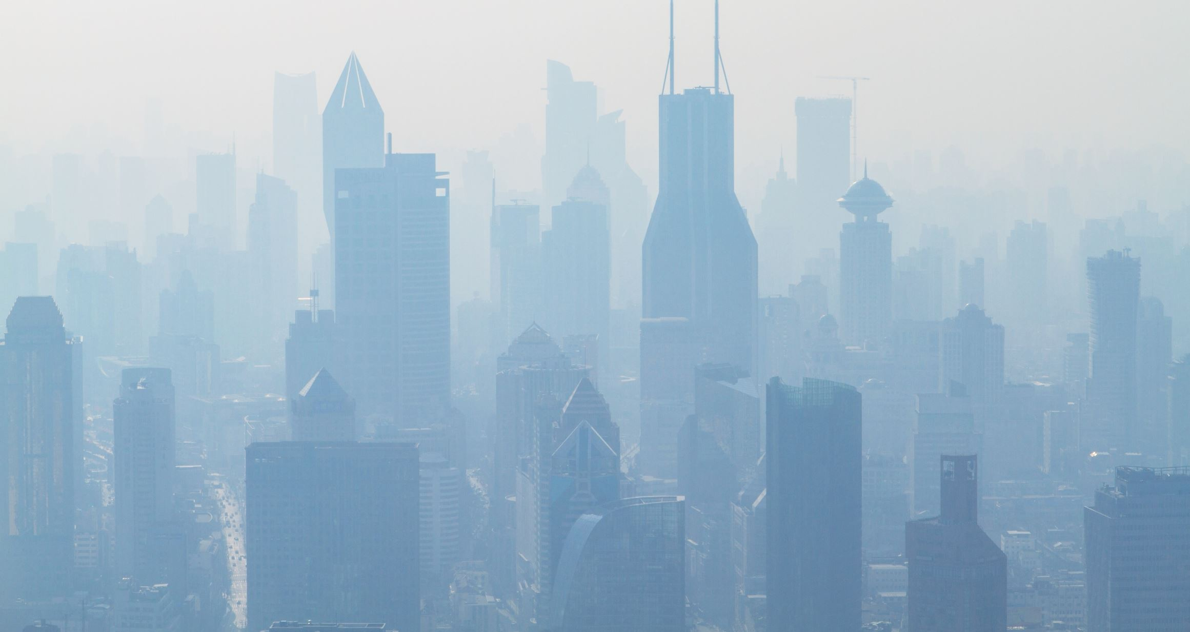A city covered in smog, a type of severe air pollution: Image Credit:  Holger Link via Unsplash