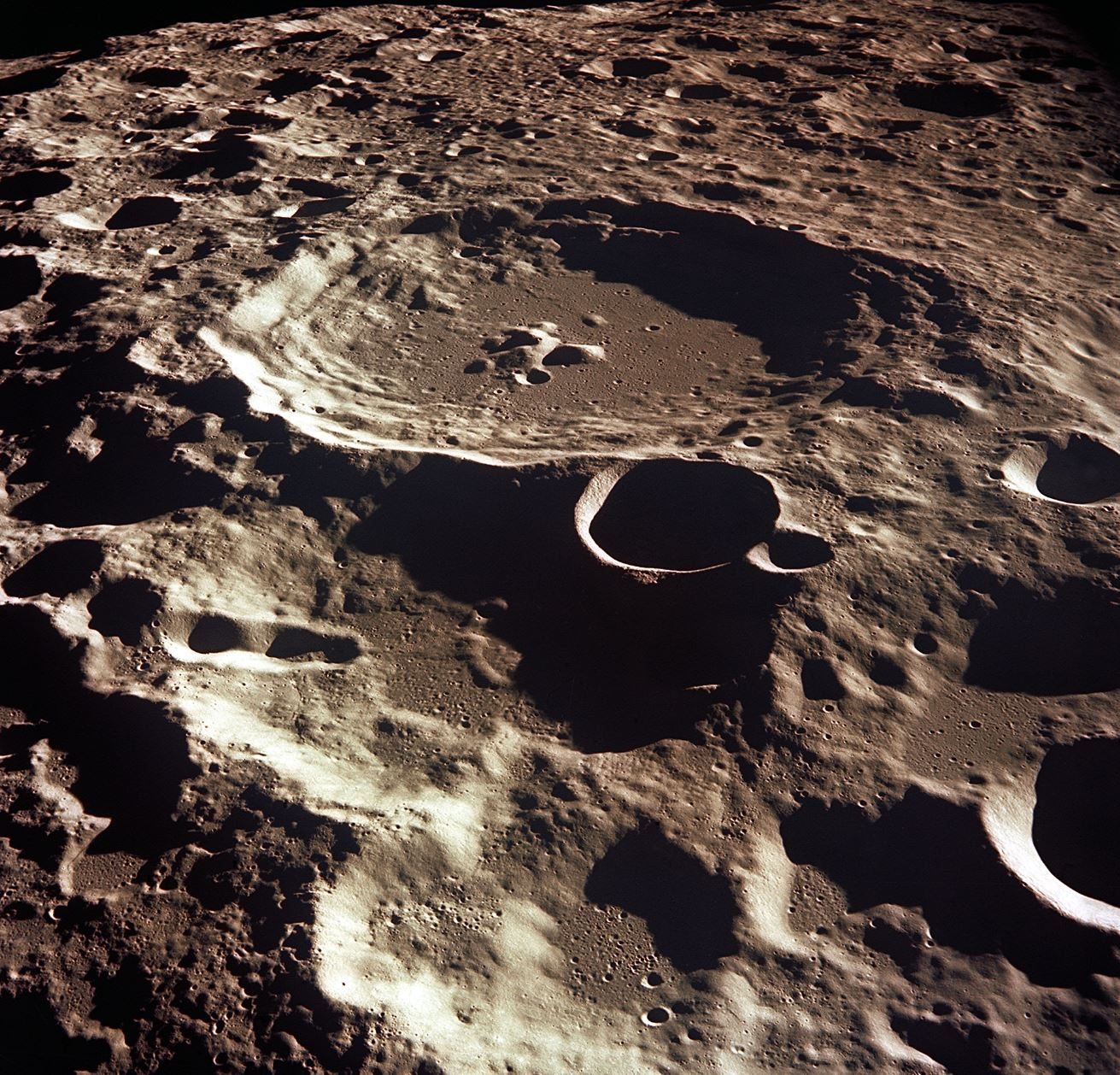 The crater Daedalus on the far side of the Moon as seen from the Apollo 11 spacecraft in lunar orbit. Daedalus has a diameter of about 80km. - Image Credits:  NASA