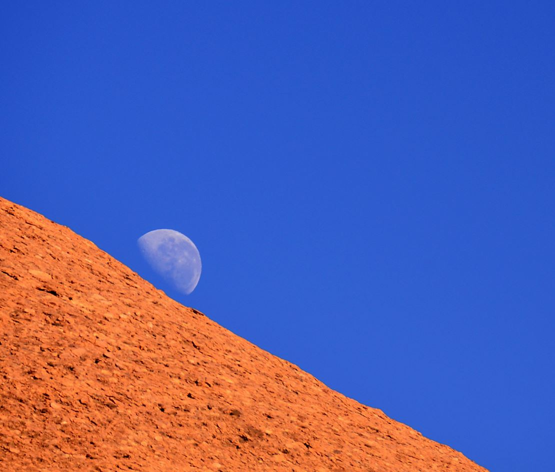 The Moon rising above Uluru: You'd need five Australias to cover the land mass of the Moon. - Image Credits:  Flickr/jurek d Jerzy Durczak ,  CC BY-NC