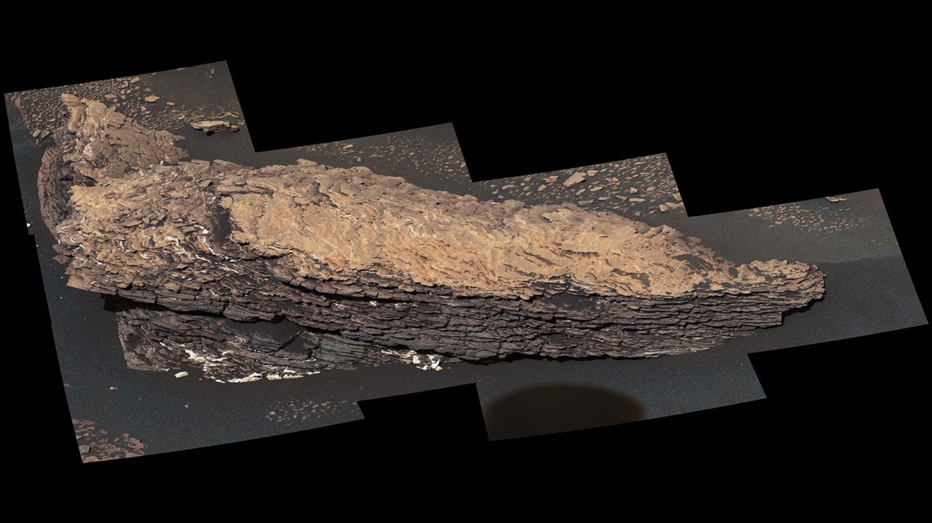"This mosaic of images shows a boulder-sized rock called ""Strathdon,"" which is made up of many complex layers. NASA's Curiosity Mars rover took these images using its Mast Camera, or Mastcam, on July 9, 2019, the 2,461st Martian sol, or day, of the mission. - Image Credit: NASA/JPL-Caltech/MSSS"
