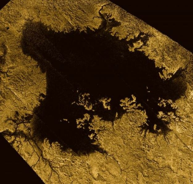 Ligeia Mare, shown in here in data obtained by NASA's Cassini spacecraft, is the second largest known body of liquid on Saturn's moon Titan. It is filled with liquid hydrocarbons, such as ethane and methane, and is one of the many seas and lakes that bejewel Titan's north polar region - Image Credits: NASA/JPL-Caltech/ASI/Cornell