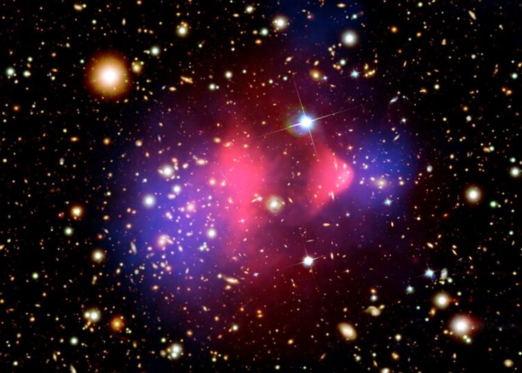 The deflection of light by gravity reveals dark matter in colliding clusters of galaxies. X-ray - Image Credits: NASA/CXC/CfA/M.Markevitch et al.; Optical: NASA/STScI; Magellan/U.Arizona/D.Clowe et al.; Lensing Map: NASA/STScI; ESO WFI; Magellan/U.Arizona/D.Clowe et al.