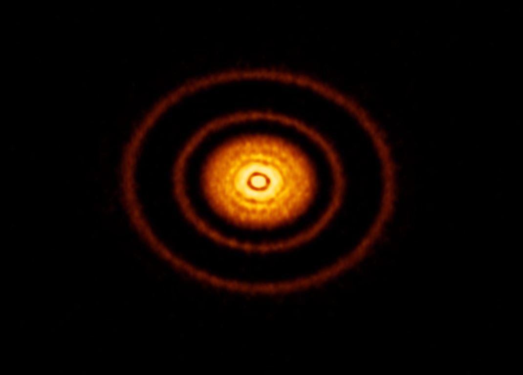 An image of a protoplanetary disk. - Image Credits:  ALMA (ESO/NAOJ/NRAO), S. Andrews et al.; NRAO/AUI/NSF, S. Dagnello