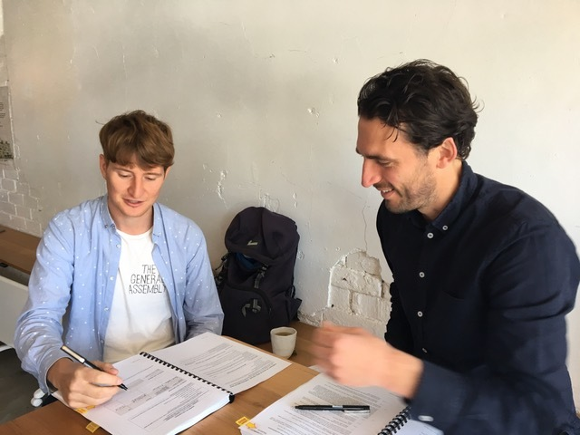 Marcelo and Liam (Founding Director, HIP V. HYPE) signing contracts