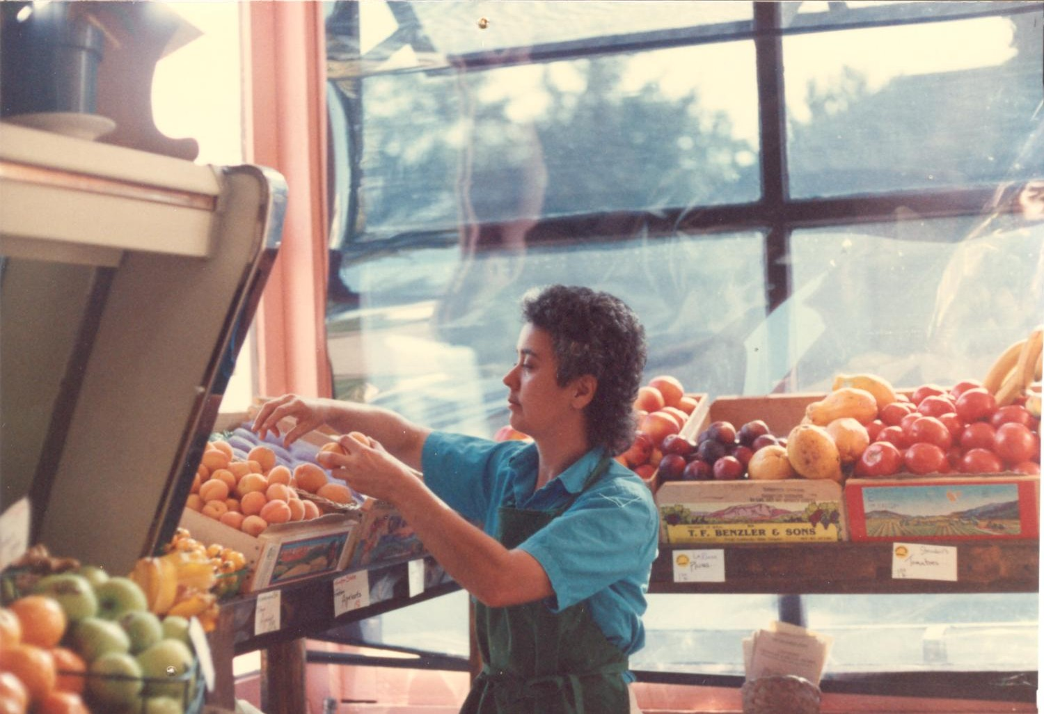 1987- Kathy setting up produce 001.jpg