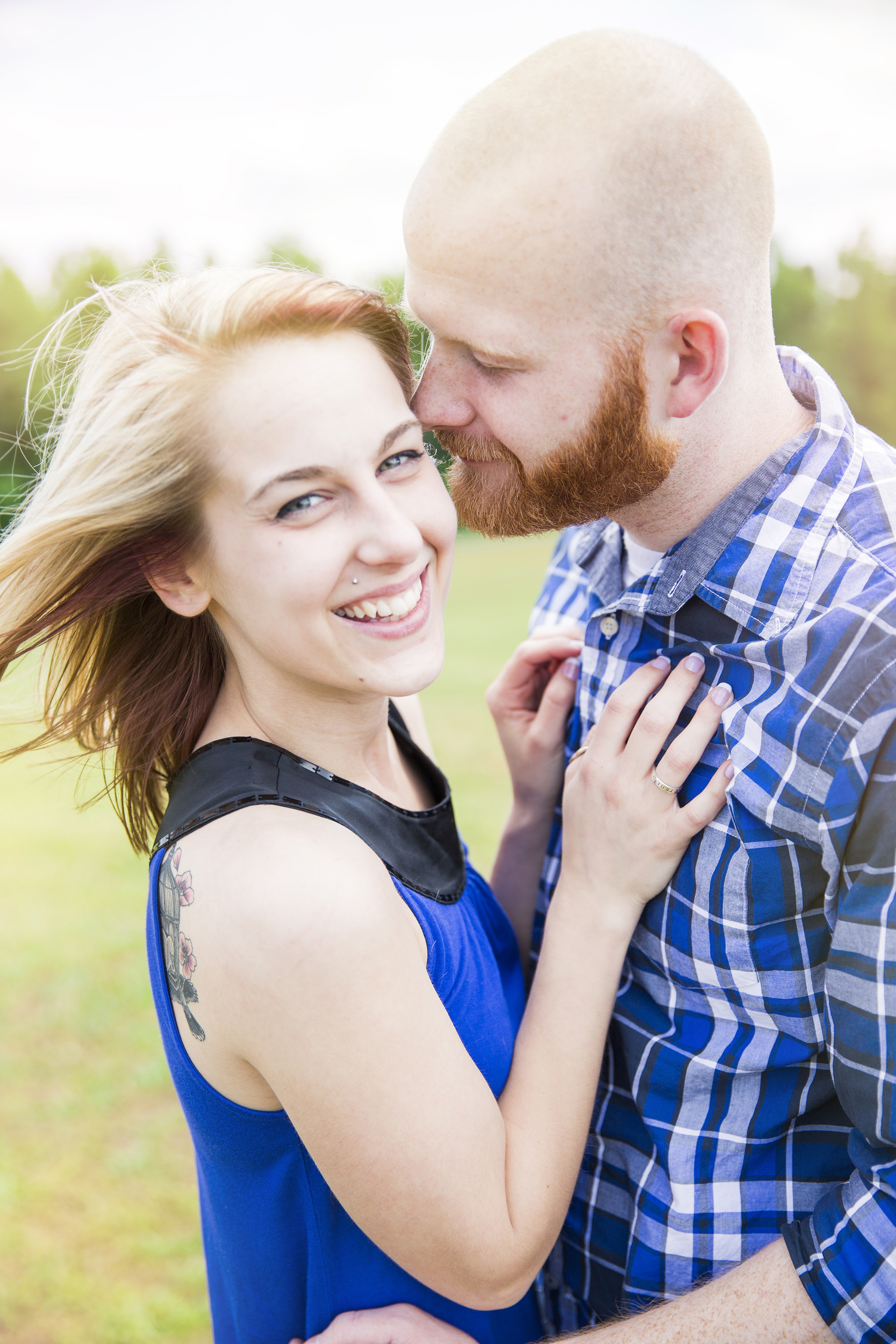 atlanta wedding photography - allison and griffin engagement - marietta square - between the blinks 1006.jpg