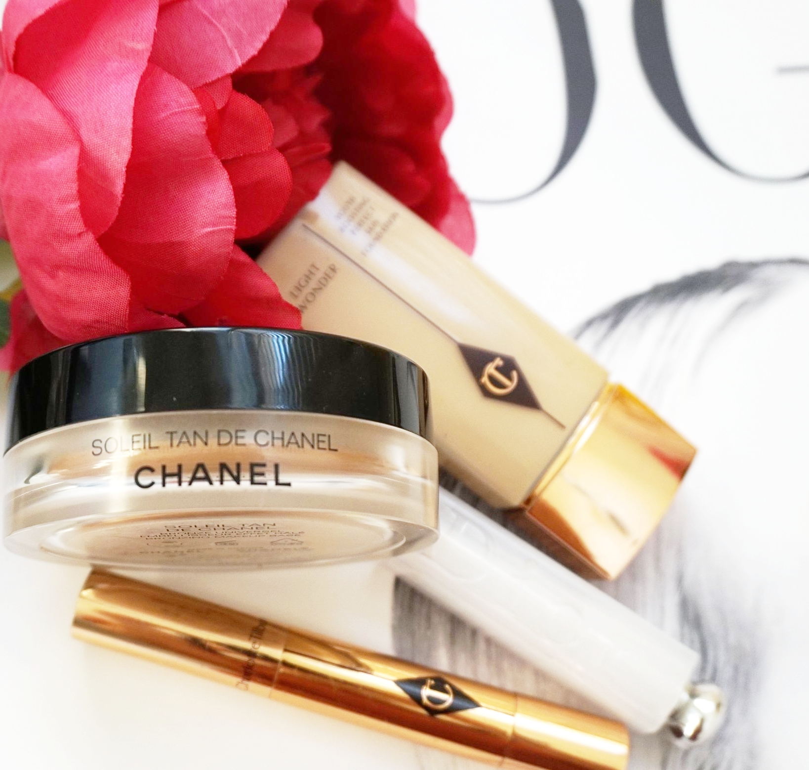 1.  Dior Makeup Fix it 2 in 1 Prime and Conceal ($45CAN)   2. Charlotte Tilbury The Retoucher Concealer ($48 CAN)   3. Charlotte Tilbury Light Wonder Foundation 6 ($55 CAN)   4. Chanel Soleil Tan De Chanel ($50CAN)