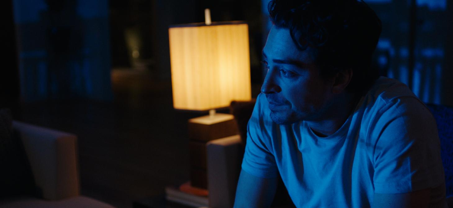 Actor Ben Feldman in character during a night interior.