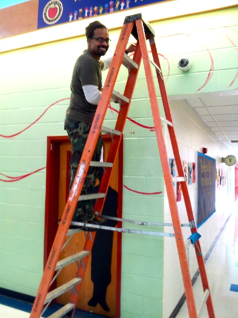 perkerson_elementary_students work with tcp resident artists_on_entryway_mural_1729.jpg