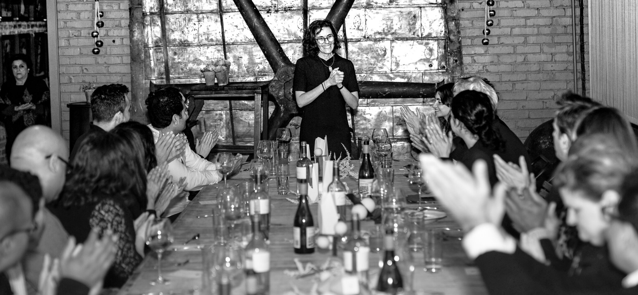 Chef Taria Camerino welcoming guests at the 2018 Holiday Dinner (image courtesy of Bedaruis Bell).