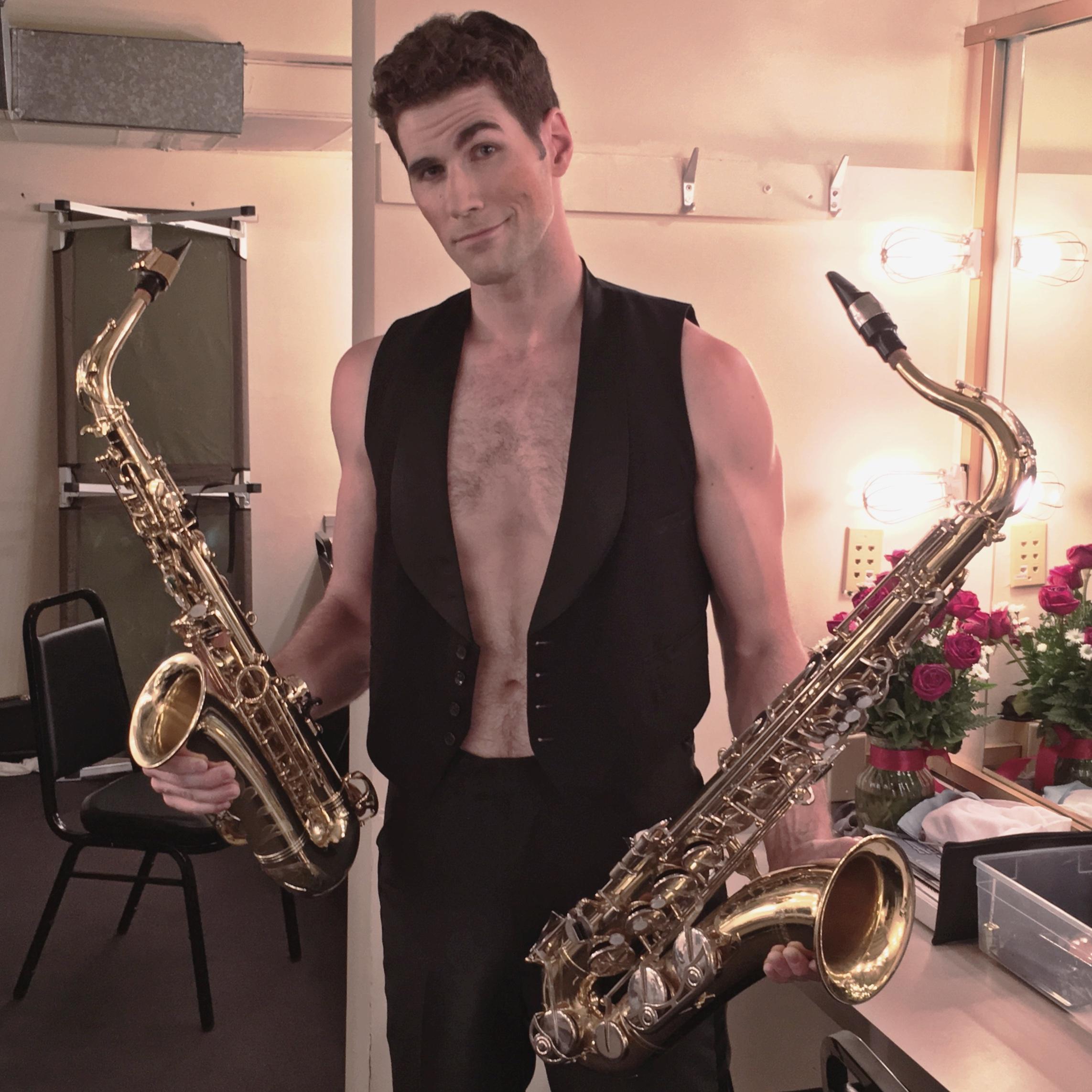 Hans, a saxophone-playing man of the Kit Kat Klub
