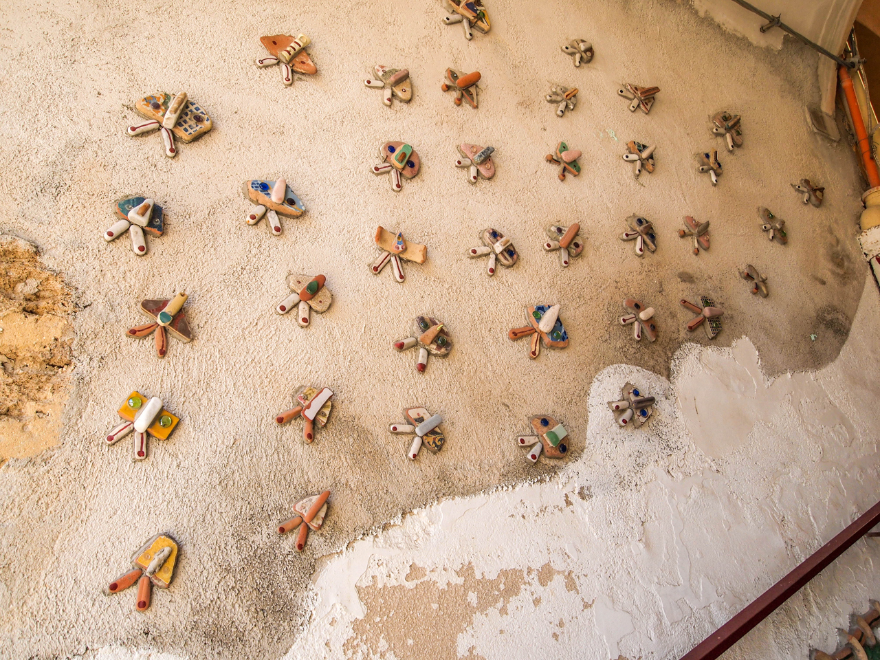 Lovely ceramic butterflies on the wall of a hallway in Sciacca