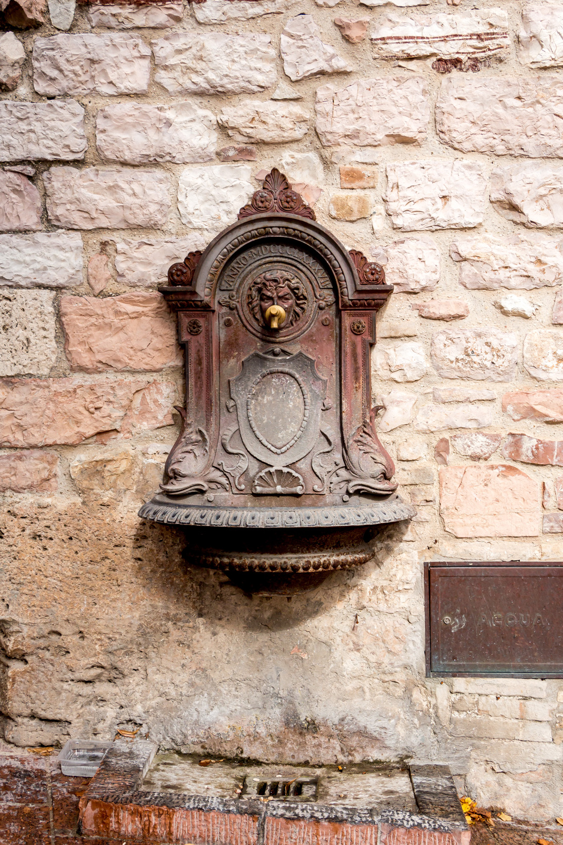 Water faucet in Assisi, Italy