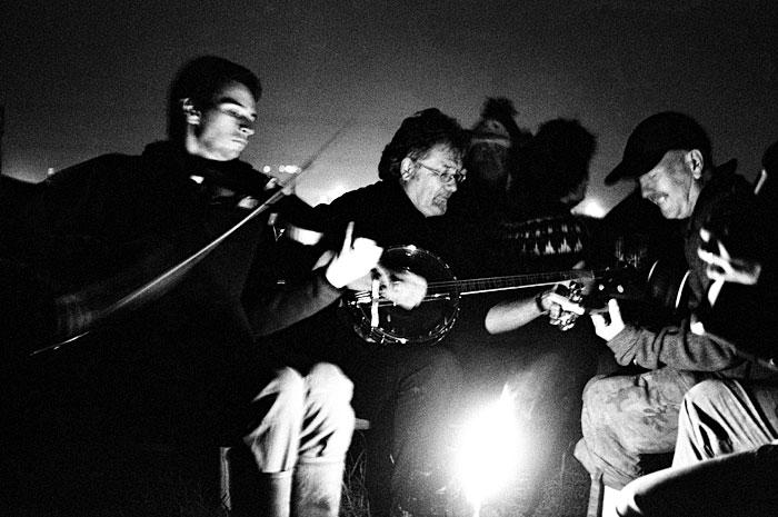 Folk music being played around the camp fire. STUNICGLAST006