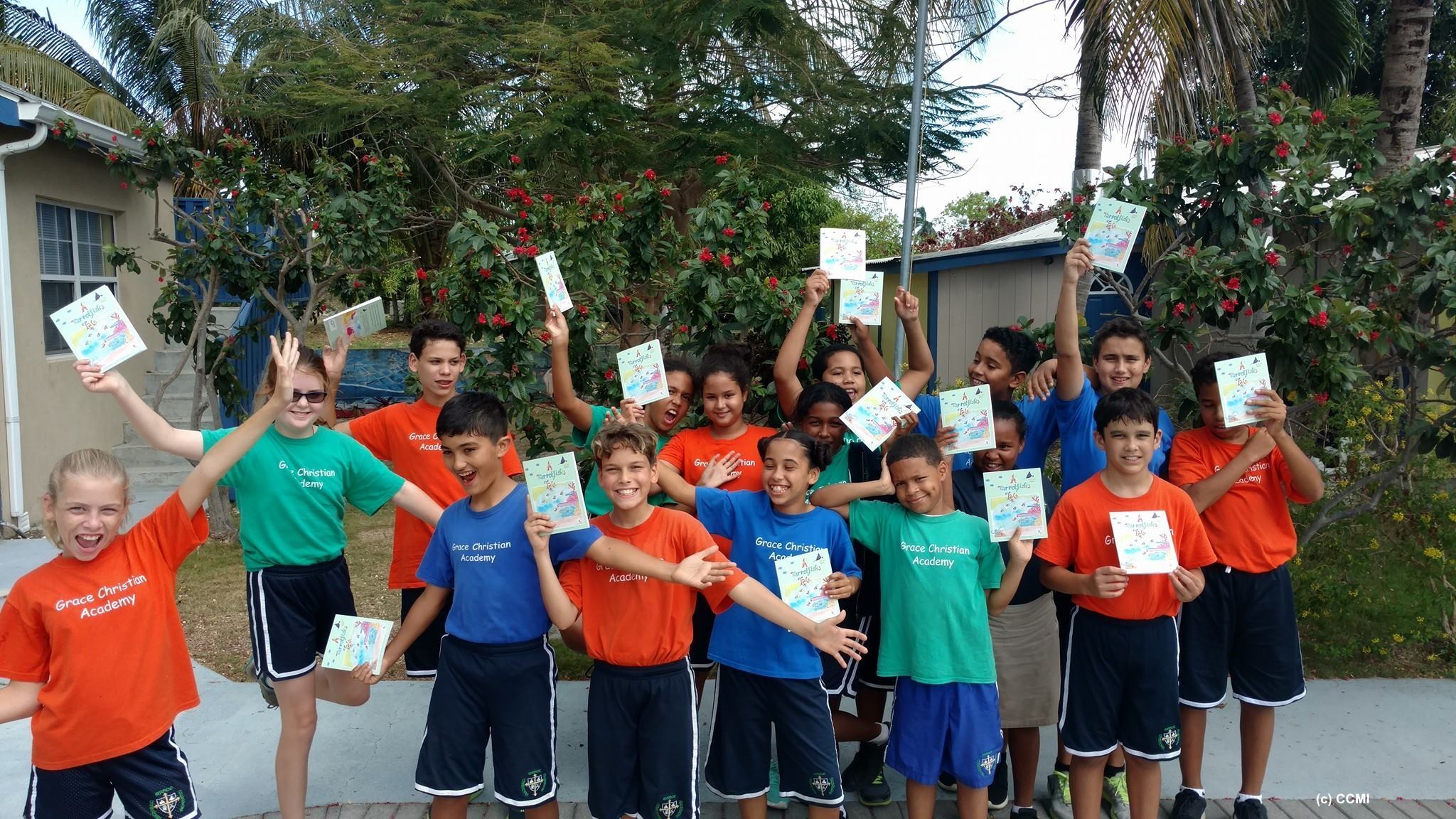 School children from Grace Christian Academy after a surprise visit from CCMI with their copies of 'A Parrotfish's Tale' CCMI Ed. Photo credit: CCMI 2016.