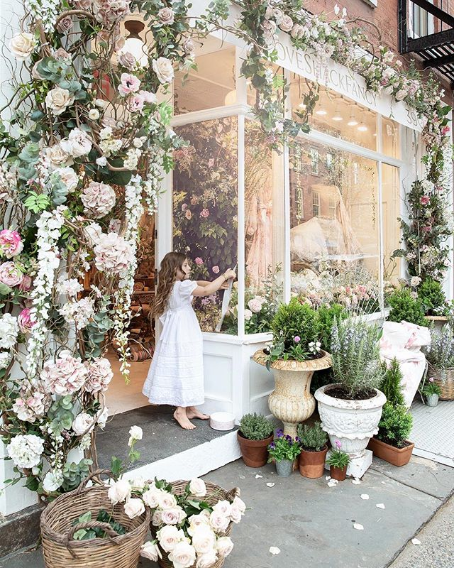 Our Very Own Secret Garden on Bleecker Street 🌸 Taken back in time, upon arrival you're greeted by dangling wisteria and tumbling roses of all shades from pinks to creams, plus baskets, and an antique iron bench layered with LoveShackFancy custom quilts and pillows. As you step into our fanciful shop, you're instantly transported to another world filled with our latest collection and magical discoveries from around the world.... #loveshackbleecker #nyc #garden #love