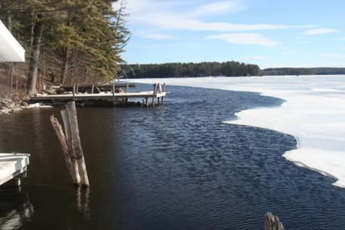 This is an example of  bad  practice with a dock de-icer. It has created a very large patch of open water which can be dangerous for winter recreationists and can also lead to greater ice damage.