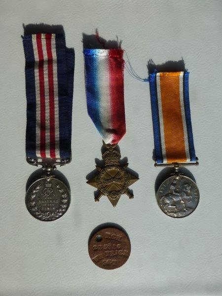 His medals and identity tag