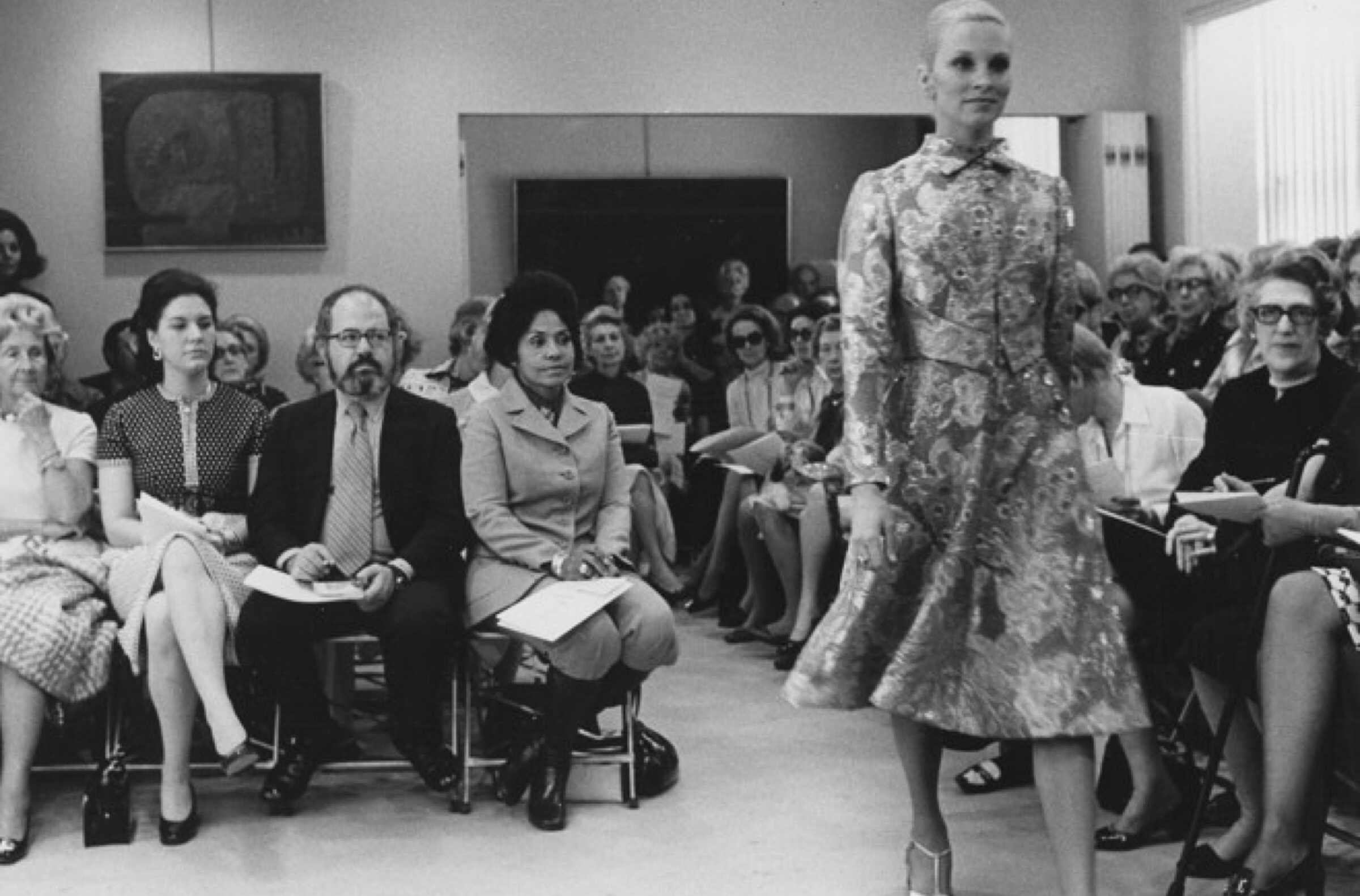 Pioneer and Curator of Ebony Fashion Fair, Eunice Walker Johnson sitting front row during a fashion presentation.