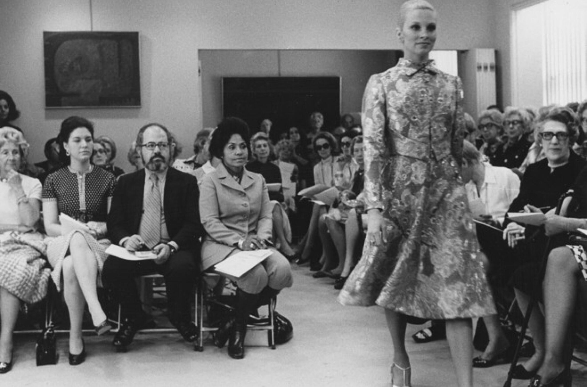 Pioneer and Curator of Ebony Fashion Fair, Eunice Walker Johnson sitting front row during a fashion presentation.