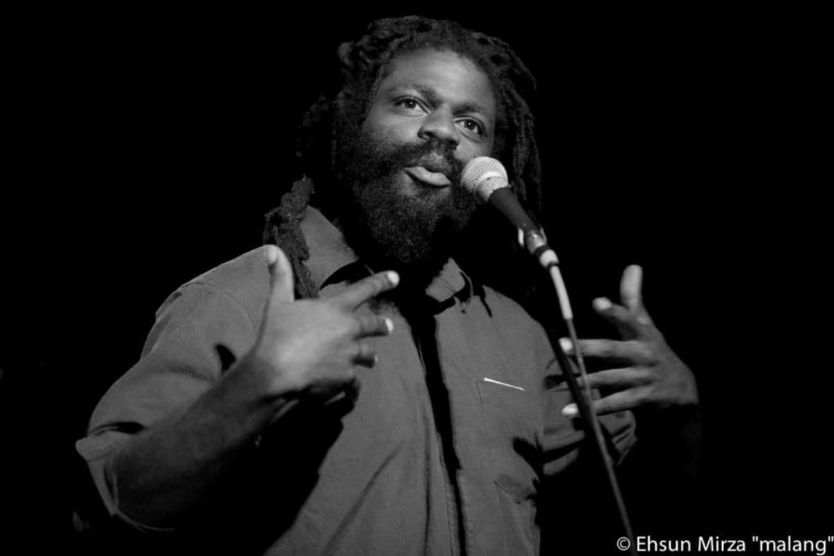 Since relocating to Providence Rhode Island from Florida in 2012,  Vatic Kuumba  has represented Providence at the National Poetry Slam from 2014-2016, and served as coach for the 2017 team. In May 2015, Vatic gave a TEDx talk explaining his original show, Rap Slam, and his vision for the next century of hip hop. Rap Slam is a hybrid of performance poetry and competitive rap. Currently vatic is a playwright in residence at as220 black box theatre as well as the AS220 youth theatre coordinator. Vatic is also serving as co-director of Providence Poetry Slam.