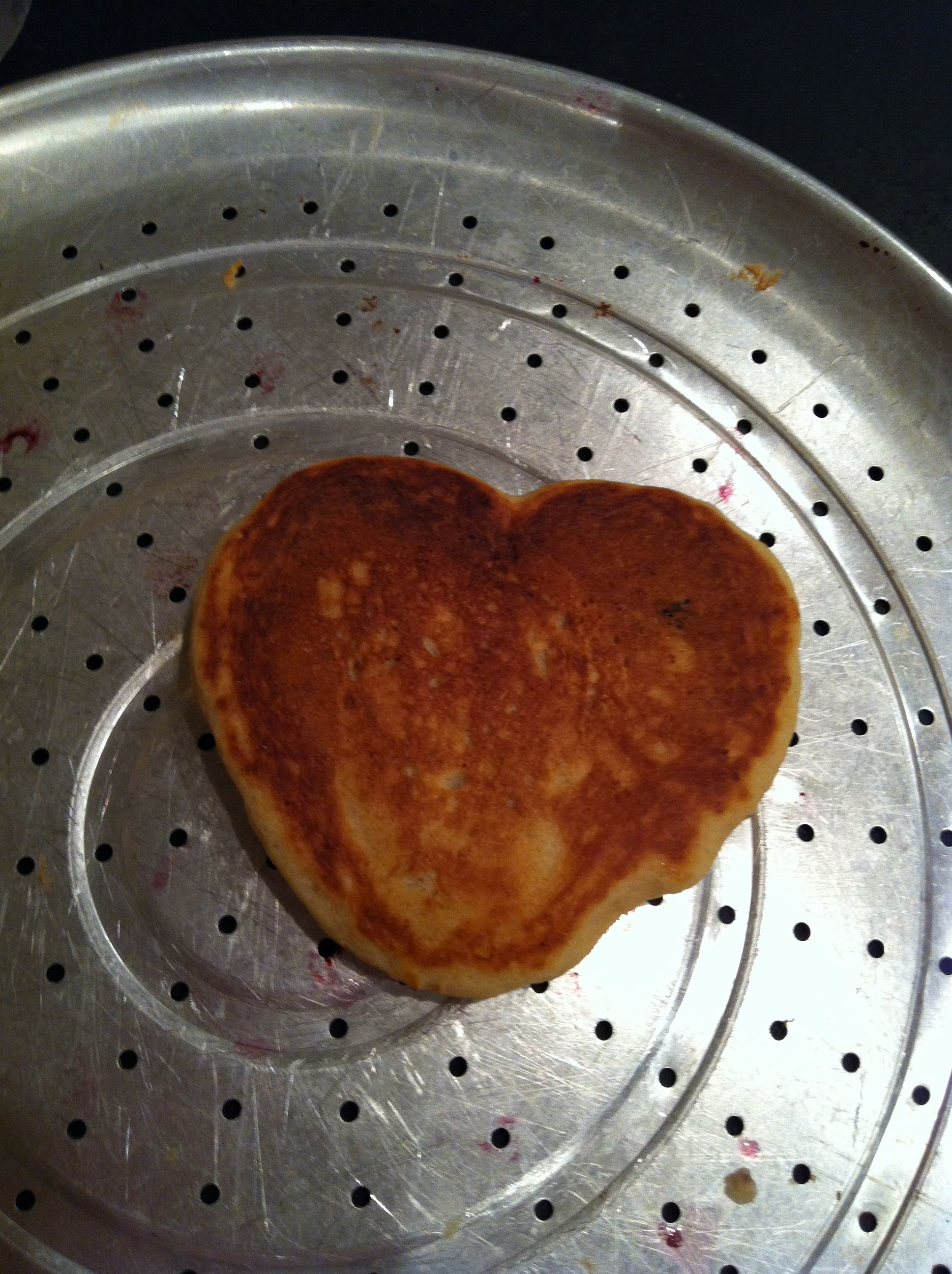 Look what happened, by accident--or not! Heart pancake.