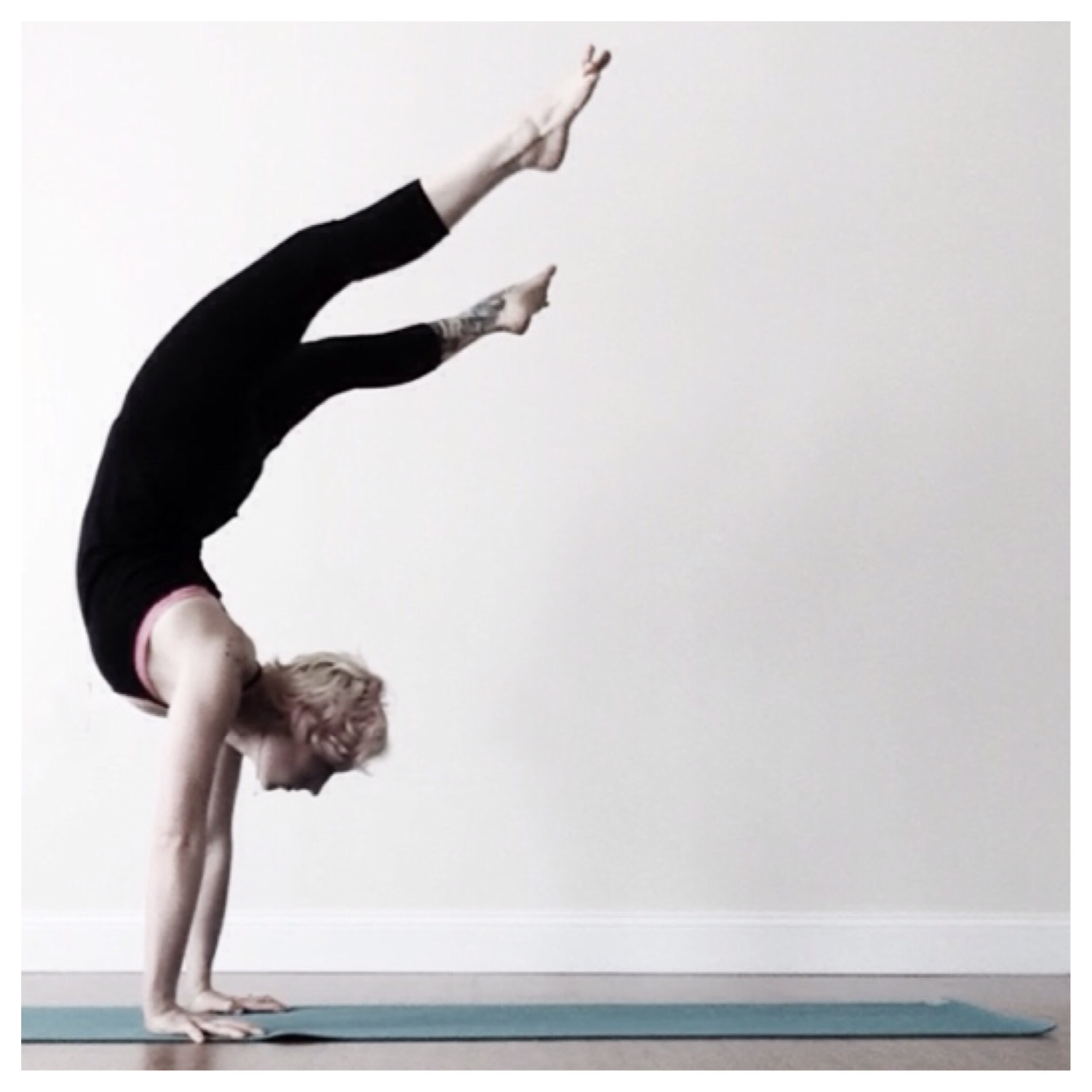 The intrepid Susan Amato, one of my yoga teachers, executing a handstand with an intentionally wonky alignment. It takes power and control to be able to master this.