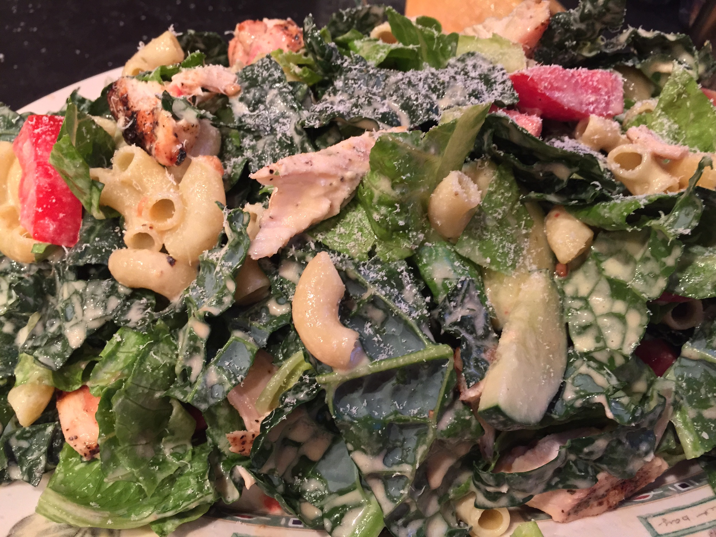 A mountain of chicken caesar salad, sans anchovy