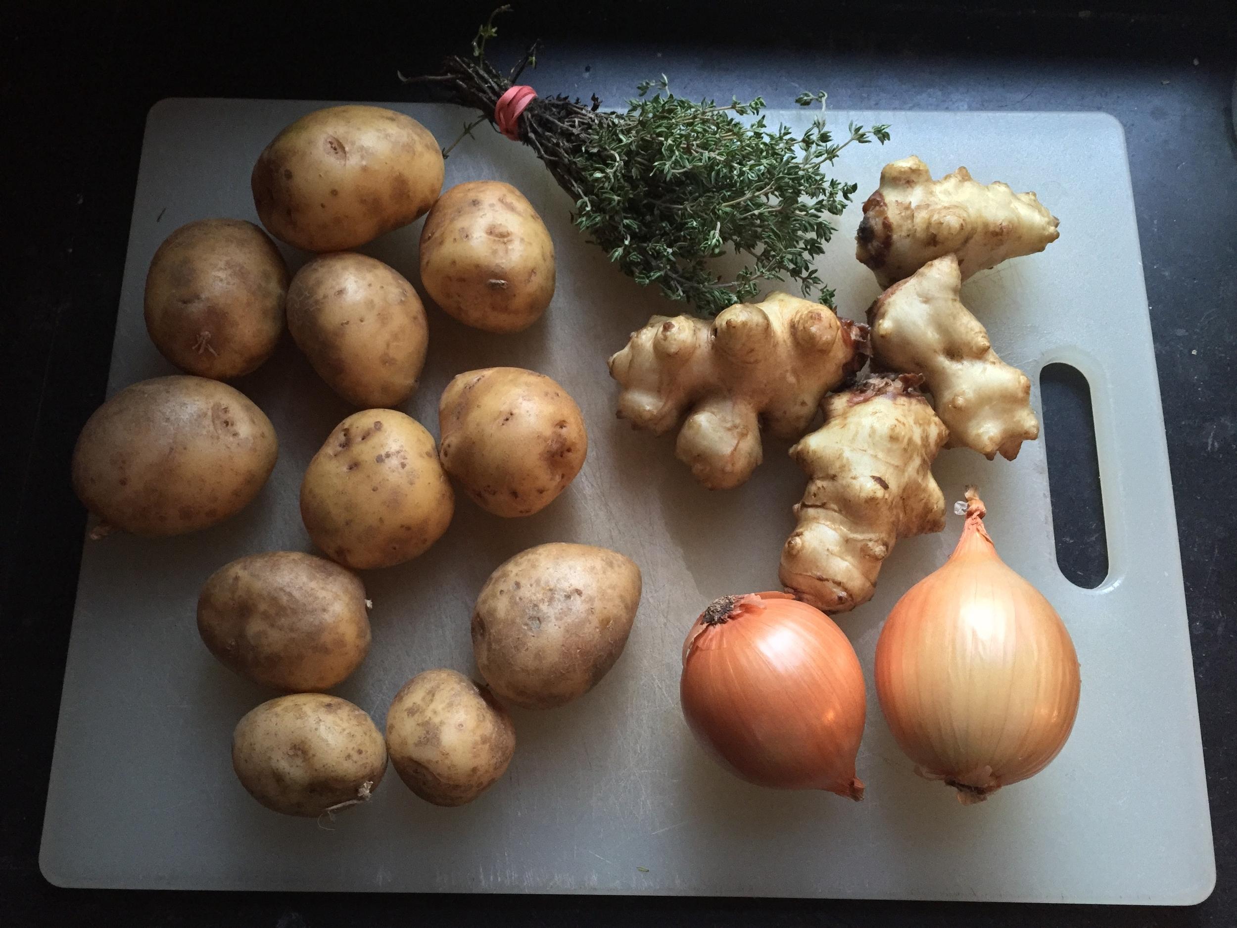 Soup mise: thyme, potatoes, sunchokes, onions.