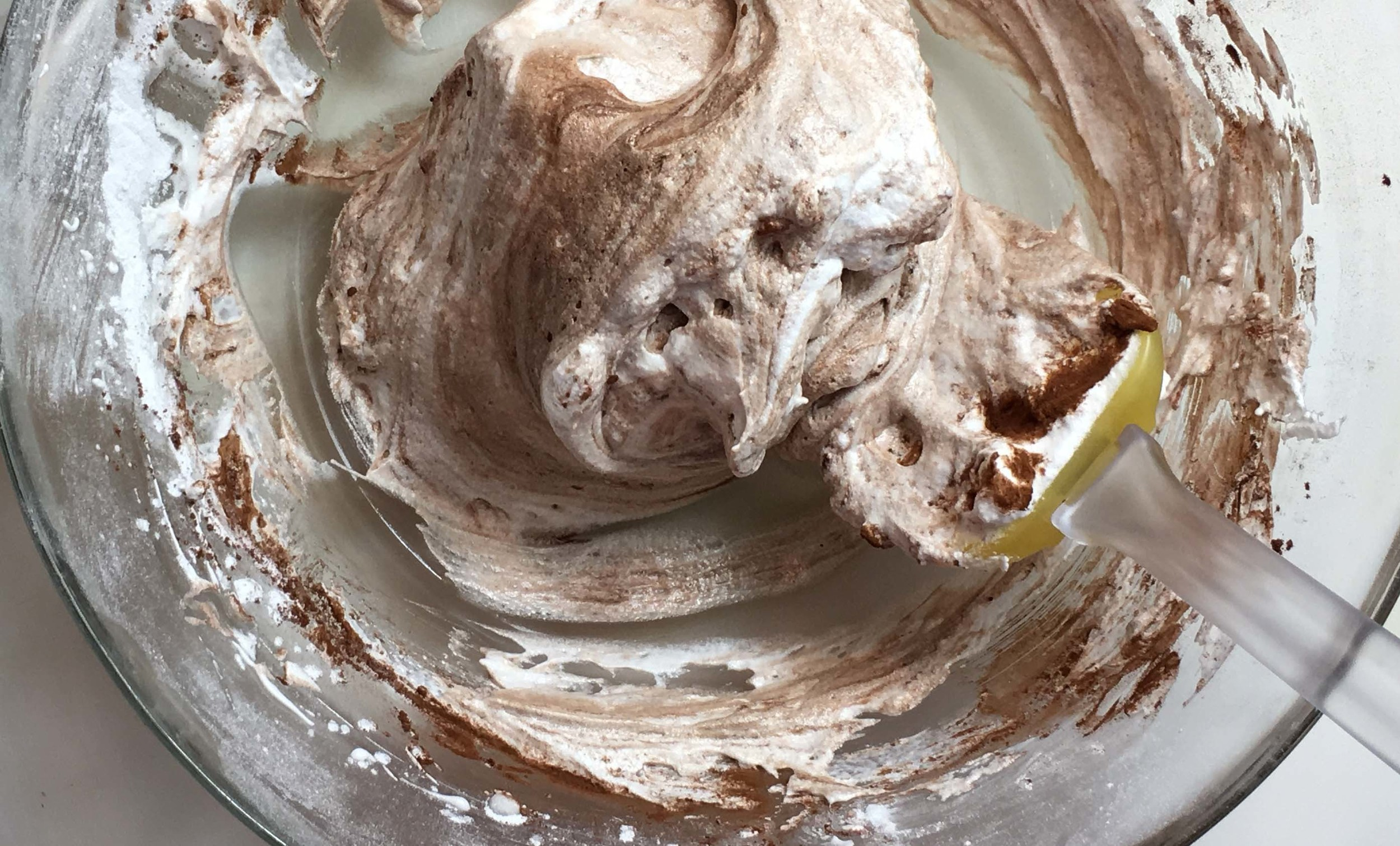 Cocoa powder, gently folded in, getting ready for low-oven meringue cookie action.